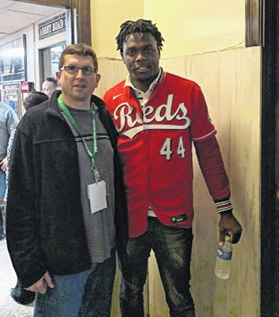 "<p style=""text-align: left;"">Aristedes Aquino of the Cincinnati Reds was part of the annual Reds Caravan, which made a stop a week ago at the WNXT radio station studios in downtown Portsmouth. Aquino is pictured with <em>Daily Times</em> sports reporter Paul Boggs."