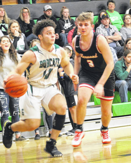 Green's Alec Smith (10) looks to drive on New Boston's Tanner Voiers (3) during Friday night's Southern Ohio Conference Division I boys basketball game at Green High School.