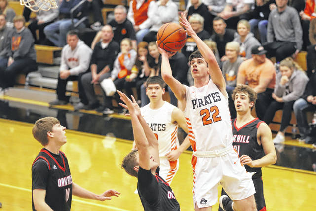 Wheelersburg's J.J. Truitt (22) paced the Pirates with 15 points as Wheelersburg defeated Oak Hill 56-49 on Tuesday night in a key Southern Ohio Conference Division II boys basketball game.
