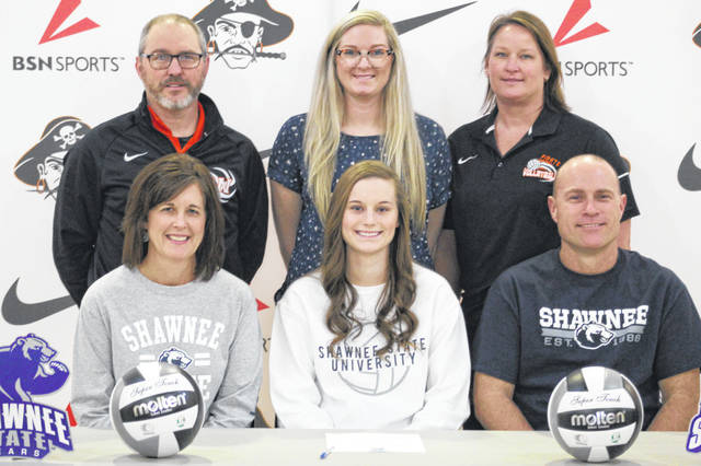 Wheelersburg High School senior Alli McQuay, seated center, announces her intention to play college volleyball at Shawnee State University. Seated with McQuay are mother Cindy McQuay (left) and father Rob McQuay (right). Standing are, from left, Wheelersburg High School head volleyball coach Allen Perry, Shawnee State University assistant volleyball coach Devan Scarberry and Wheelersburg High School assistant volleyball coach Tricia Boggs.