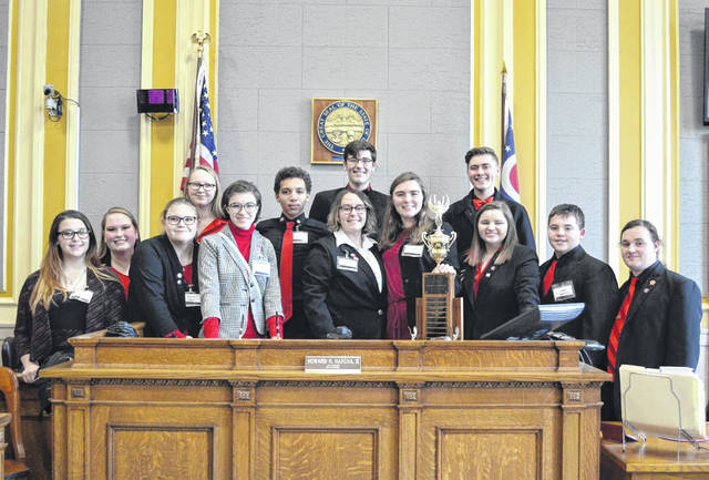2020 District Mock Trial Champions - Portsmouth West High School. Front (L to R): Natalie Marsh, Macie Jones, Anna Lovins, Cianna Newman, Whitney Campbell, Emily Scaff, Aiden Robinson, Taran Willis. Back (L to R): Coach Sarah Johnson, Tabitha Johnson, Gabe Kouns, Evan Green, John Jones. Not pictured: Legal Advisor, Jay Willis