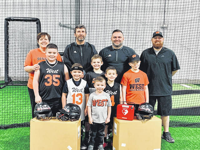 (Left to right) Dani Coleman, Chris Rapp, Chad Lore, Josh Simpson Front row: Jace Lore, Tyce Lore, Easton Simpson, Cameroon Simpson, Daulton Cassidy
