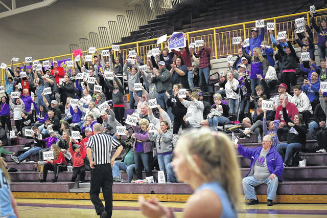 "Valley fans hold their ""1000"" signs to celebrate Call becoming the eighth Lady Indian in program history to pass the one-thousand point mark."