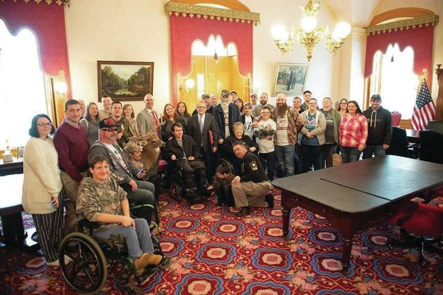 True Lure Inc and the office's of Mike DeWine met in celebration of Scioto County's efforts for the handicapped.