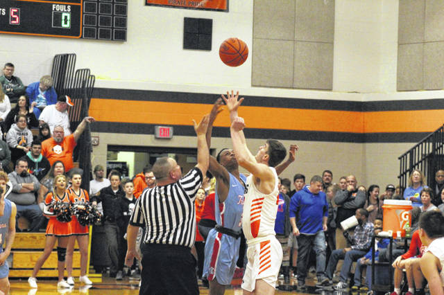 Wheelersburg junior Carter McCorkle wins the opening tip versus Portsmouth sophomore Dariyonne Bryant in the Pirates' 37-point win on Saturday.