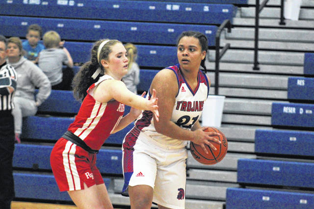 Portsmouth senior Jaiden Rickett (21) posted a near double-double in the Lady Trojans' 45-35 home win over Rock Hill in Ohio Valley conference girls play.