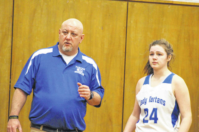 East coach Matt Miller and sophomore guard Kacie Conley discuss the Lady Tartans game-plan during their 70-43 win over Whiteoak on Saturday in SOC I play.