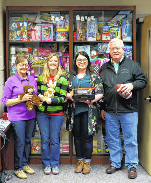Left to right: Mary Lee Justice, Kaitlin Setty and Julia Huffman ( Local History staff at the Portsmouth Public Library) with Dan Palmer from Operation Grace
