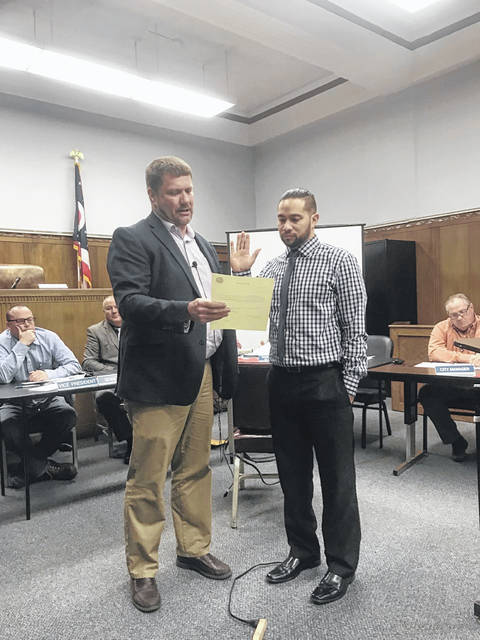 Martell sworn in by Solicitor Haas