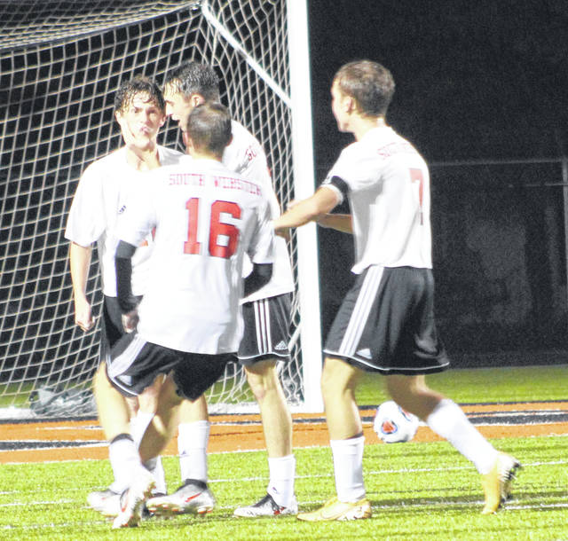 South Webster's Gavin Bennett (10) reacts and celebrates with his teammates after scoring the Jeeps' go-ahead goal during Wednesday night's Division III boys soccer regional semifinal match against Lynchburg-Clay at Waverly's Raidiger Field.