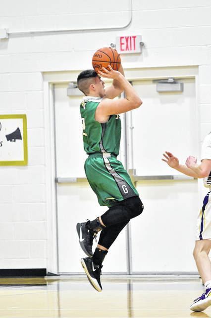 Green senior Gage Samspon (2) scored his 1,000th career point as a Bobcat on this shot during Green's 57-54 road win over Ironton St. Joe in SOC I play.
