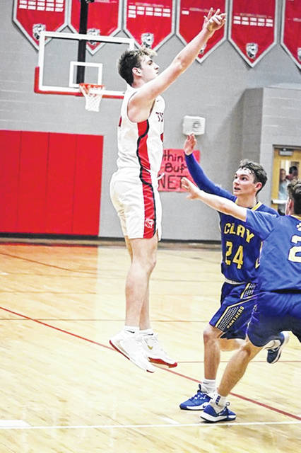 New Boston junior Kyle Sexton scored his 1,000th career point during the Tigers' 59-36 home win over Clay in Southern Ohio Conference Division I play.