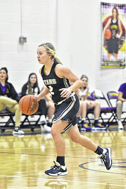 Notre Dame senior Taylor Schmidt (2) scored a season-high 20 points off eight-made field goals during the Lady Titans' 26-point road win over Valley in non-league play.