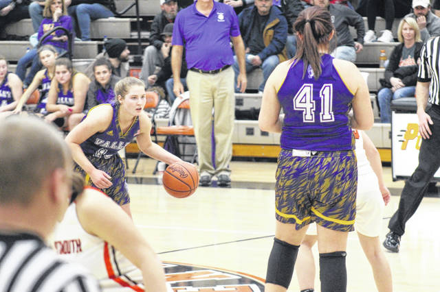 Valley senior Nichole Gilliland sets a screen for fellow senior Bre Call during the Indians' 44-41 road win over West in Southern Ohio Conference Division II play.