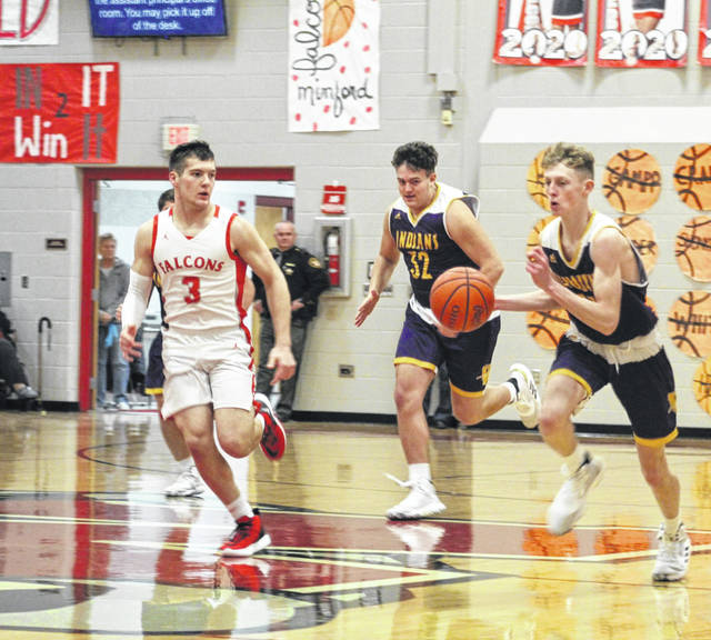 Valley's Bryce Stuart (24) leads a fast break with teammate Mason Zaler (32) trailing and Minford's Elijah Vogelsong-Lewis (3) defending during Tuesday night's Southern Ohio Conference Division II boys basketball game at Minford High School.