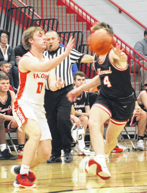 Minford senior Nathan McCormick (10) passes around the defense of New Boston's Kyle Sexton (4) during Tuesday night's non-league boys basketball game at Minford High School.