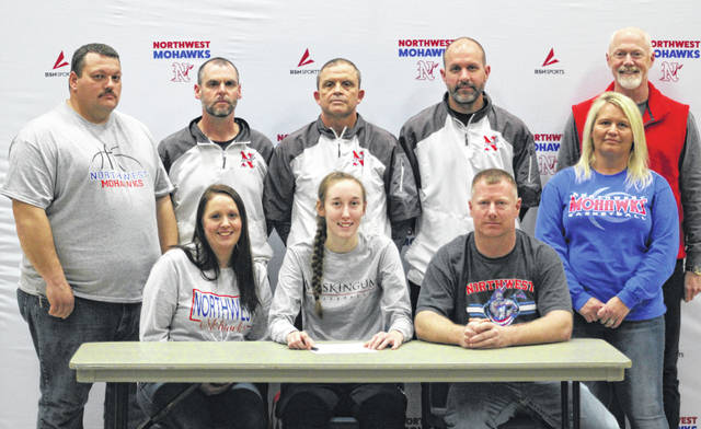 Northwest High School's Keirah Potts, seated center, announces her intention to play college basketball for Muskingum University. Seated with Potts are mother Krista Eichenlaub (left) and father Dewey Potts (right). Standing are, from left, stepfather Anthony Eichenlaub, Northwest assistant girls basketball coach Rick Powell, Northwest head girls basketball coach and athletic director Dave Frantz, Northwest assistant girls basketball coach Brooks Fry, Northwest High School principal Jason Burton and stepmother Debbie Potts.
