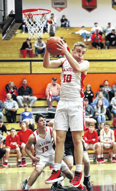 Minford senior Nathan McCormick (10) grabs a rebound during the Falcons' Division III boys basketball sectional semifinal game against Coal Grove on Wednesday night.