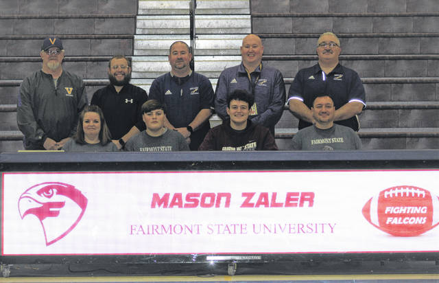 Valley High School senior Mason Zaler, seated second from right, announces his intention to play college football for Fairmont State University. Seated with Zaler are, from left, mother Claudia Zaler, brother Ryan Zaler and father Matt Zaler; standing are, from left, Valley High School assistant coach Monte Spriggs, Valley High School assistant coach Bill Berry, Valley High School assistant coach Jason Fell, Valley High School assistant coach Phil Shepherd and Valley High School head football coach Darren Crabtree.