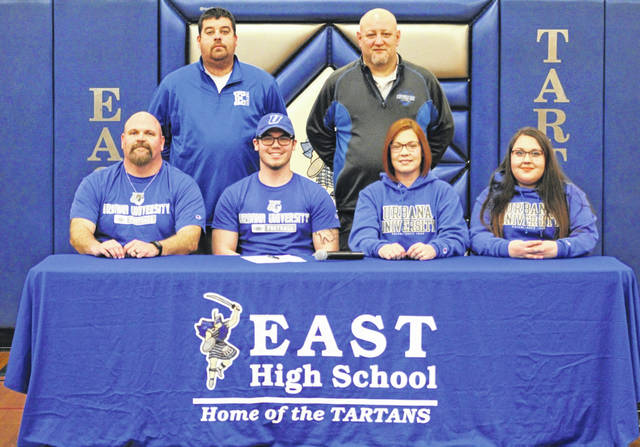 East High School's Braidan Haney, seated second from left, announces his intention to play college football for Urbana University. Seated with Haney are, from left, father Dan Haney, mother Sara Haney and sister Brooke Haney. Standing are East High School athletic director Adam Bailey (left) and East High School head football coach Matt Miller (right).