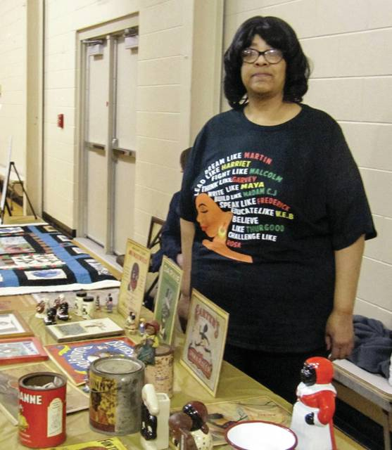 14th Street Community Center Director Maureen Codogan, proudly displaying her collection of artifacts of African American history.