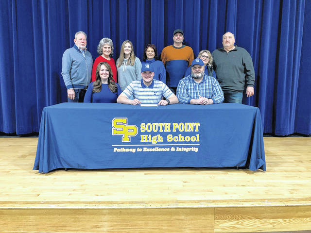 Former East student-athlete and South Point senior Grant Gifford (center seated) signed to continue his education and football career at Urbana University. Gifford played for the Tartans during his freshman and sophomore seasons before transferring to South Point when his father, James, was hired as the head football coach.