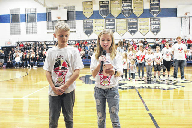 Mamie Brisker Pettit's niece and nephew, (L-R) J.J. and Ryan Purcell, spoke about their aunt prior to the start of the 1st annual Mamie Brisker Pettit Memorial Scholarship Benefit game between Notre Dame and Minford.