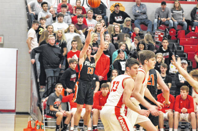 Wheelersburg sophomore Eli Swords (13) shoots a corner three in the Pirates' 68-47 road win over Minford in Southern Ohio Conference Division II play.