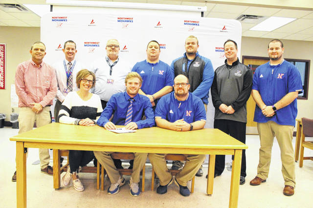 Northwest senior Billy Crabtree (center seated) signed to continue his education and play football at Kentucky Christian University at his signing ceremony Wednesday afternoon.