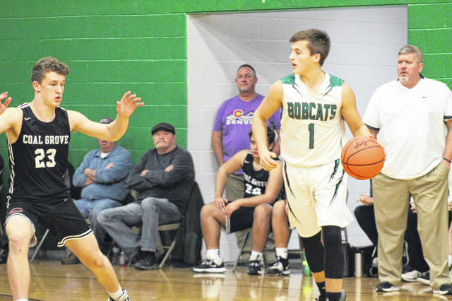Green senior Trevor Darnell (1) handles the ball during the Bobcats' 65-57 Senior Night home loss to visiting Coal Grove in non-league play, Tuesday.