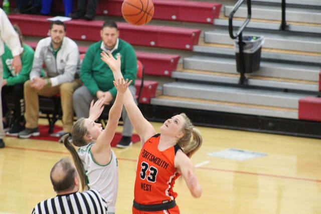 West senior Morgan Rigsby (33) goes up for the tip in the Lady Senators' Division III sectional semifinal versus Fairland, Wednesday, at Jackson High School.