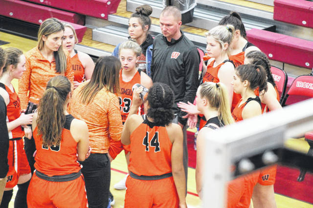 West coach Megan Artrip gives instructions to the Lady Senators in a timeout during their Division III sectional semifinal versus Fairland, Wednesday, at Jackson High School.