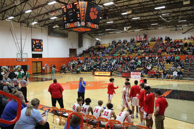 The Portsmouth Trojans and Western Indians played their Division III boys sectional semifinal game at Waverly's Downtown Arena, Monday.