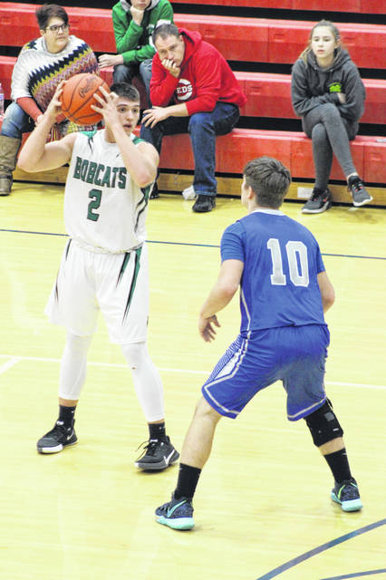 Green senior Gage Sampson (2) posted game-highs with 28 points and 17 rebounds in the Bobcats' 66-37 Division IV sectional semifinal win over East, Tuesday, at Northwest High School.