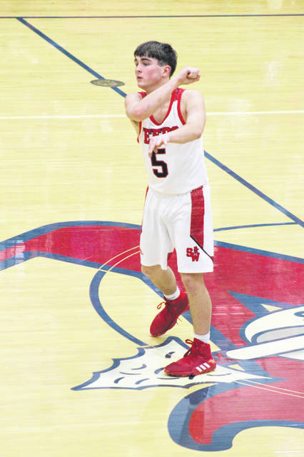 South Webster senior Andrew Smith (5) scored each of his 13 points during the second half of the Jeeps' 67-39 win over Huntington, Wednesday, at Northwest High School.