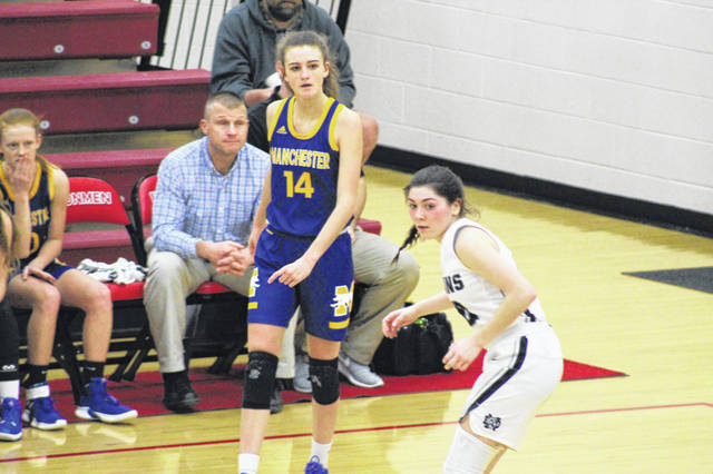 Notre Dame senior Olivia Smith (10) held Manchester junior Brooke Kennedy to just one point through the first three quarters of Thursday's Division IV district semifinal at Jackson High School.