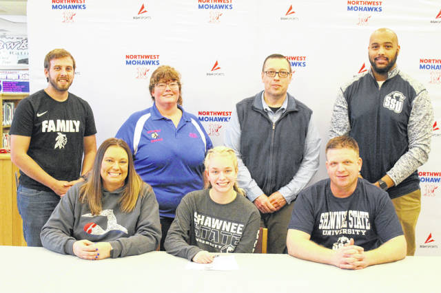 Northwest senior Maddie 'Mad Dog' Montavon signed her letter of intent to join the women's swimming program at Shawnee State University at her signing ceremony, Friday. Pictured: (Seated L-R) Amy Montavon, Maddie Montavon, Jarrod Montavon. (Standing L-R) Adam Schroeder, Michelle Tackett, Tim Amburgey, Gerald Cadogan.