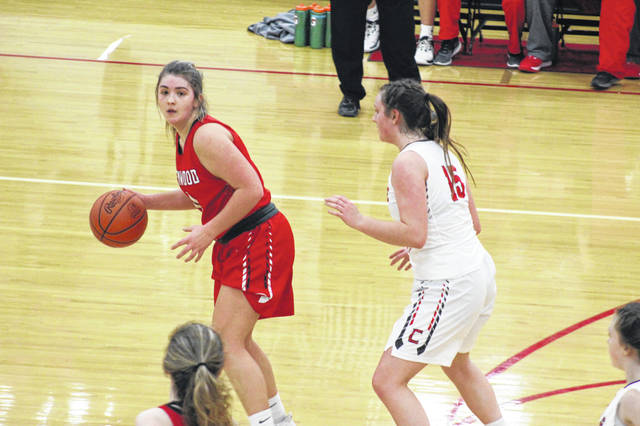 New Boston senior Lexus Oiler (0) scored her 1,000th career point during the first quarter of the Lady Tigers' season-ending loss to Trimble in the Division IV district semifinals, Saturday.