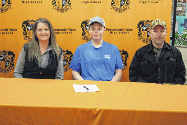 Portsmouth West senior C.J. Whitt (center) signed his letter of intent to continue his education and join the bowling team at Thomas More University located in Crestview Hills, Ky. Pictured (L-R): Jenny Whitt, CJ Whitt, Chad Whitt.
