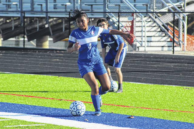 Northwest senior Eva Reyes (4) attempts a cross-pass during a Lady Mohawks' game versus West.. Reyes was named first team all-SOC and Southeast District during the Lady Mohawks' 2019 campaign.