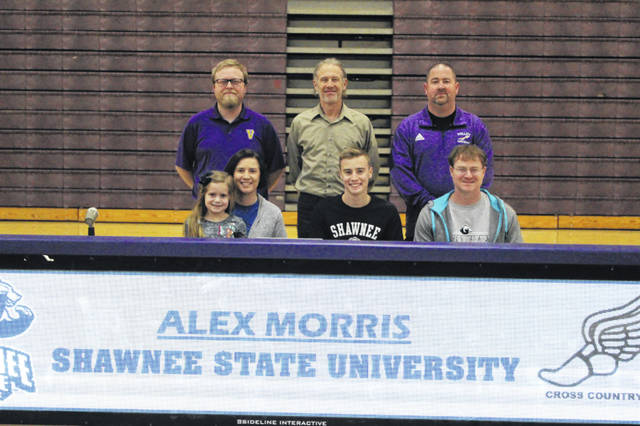 Valley senior Alex Morris (center seated) signed his letter of intent to continue his education and track and cross country careers at Shawnee State University. Pictured (L-R front): Layla Morris, Jessie Morris, Alex Morris, Carlos Morris. (L-R back): Ryan Conley, Eric Putnam, Jason Fell.
