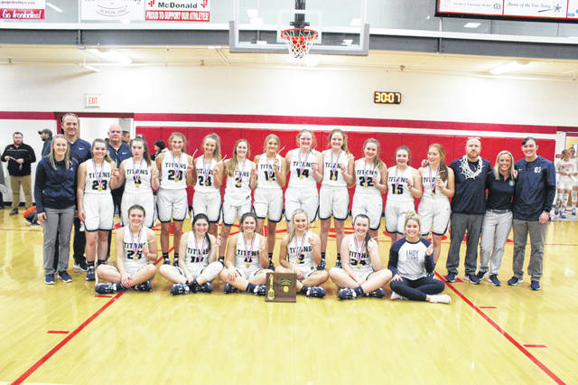 The Notre Dame Titans won their third-straight Division IV district title in a 49-35 decision over Belpre, Thursday, at Jackson High School.