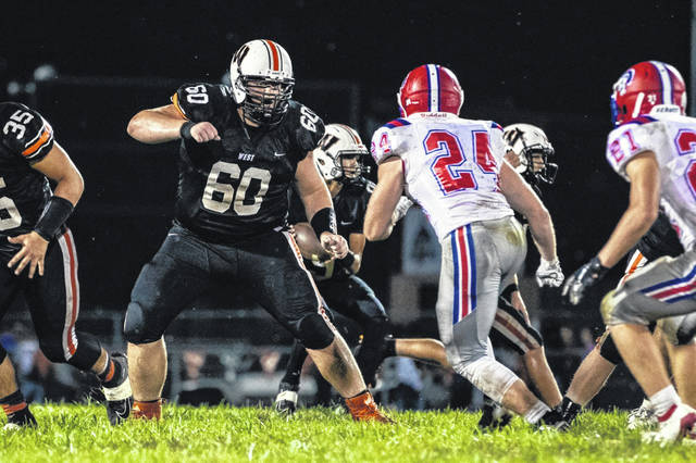 West senior Joe Igaz (60) pass-protect blocks during the Senators home game versus Portsmouth in week two of the 2019 football season.