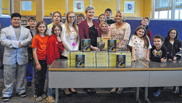 Fifth-grade students at Clay with their teacher Maria Allison, Rotary Club President Samantha Comer, and school librarian Cindy Parkes.