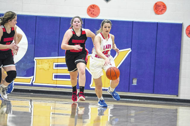 Northwest's Valerie Copas (10) dribbles the ball upcourt past Crooksville defenders during Thursday's Division III girls basketball sectional semifinal game at Valley High School.