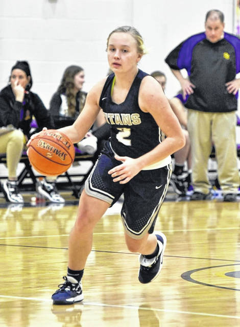 Notre Dame senior Taylor Schmidt and her Lady Titan teammates take on Belpre in Thursday's Division IV girls basketball district championship game at Jackson High School.