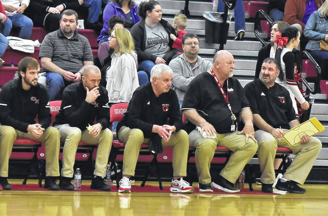 Norm Persin, seated center, sits with his assistant coaches prior to his final game as Oak Hill Oaks' boys basketball head coach. His assistants included, from left, Mitchell Hale, Heath McKinniss, Jim Slone and Michael Hale.