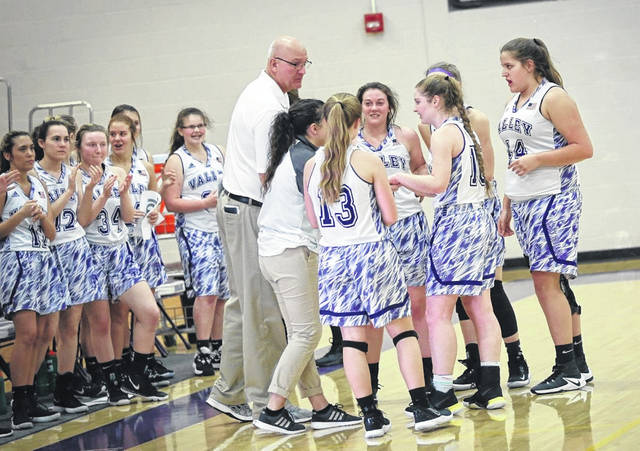 Mark Merritt, center, is shown here offering instruction to his Valley Lady Indians' girls basketball team during a home game this past season.