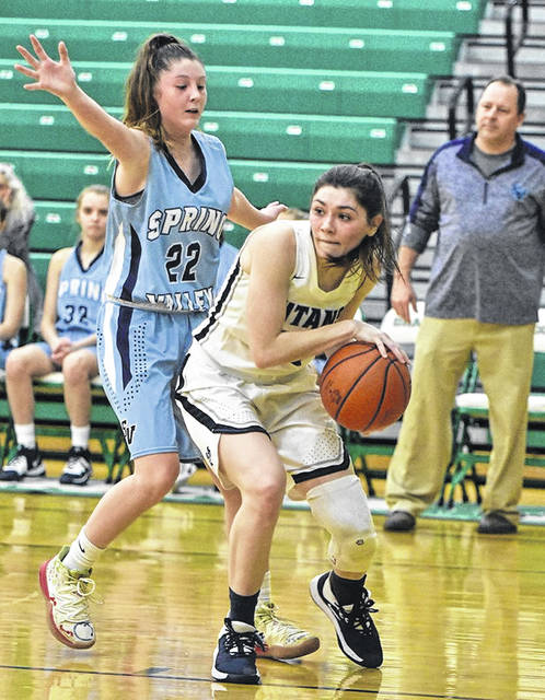 Notre Dame senior Olivia Smith (10) and her Lady Titan teammates take on Fort Frye for the Division IV regional championship on Saturday night at Pickerington North High School.