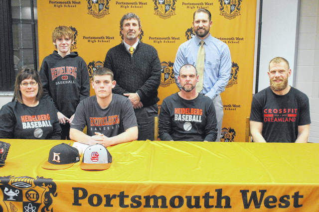 Portsmouth West senior Cade Powell (left center seated) signed his letter of intent to continue his education and baseball career at Heidelberg University at his signing ceremony, Tuesday afternoon. Pictured: (Seated L-R) Teresa Powell, Cade Powell, Rick Powell, Michael Longmire (Standing L-R) Carson Powell, Chris Rapp, Ben Johnson